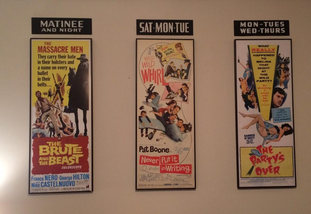 vintage movie posters in black picture frame